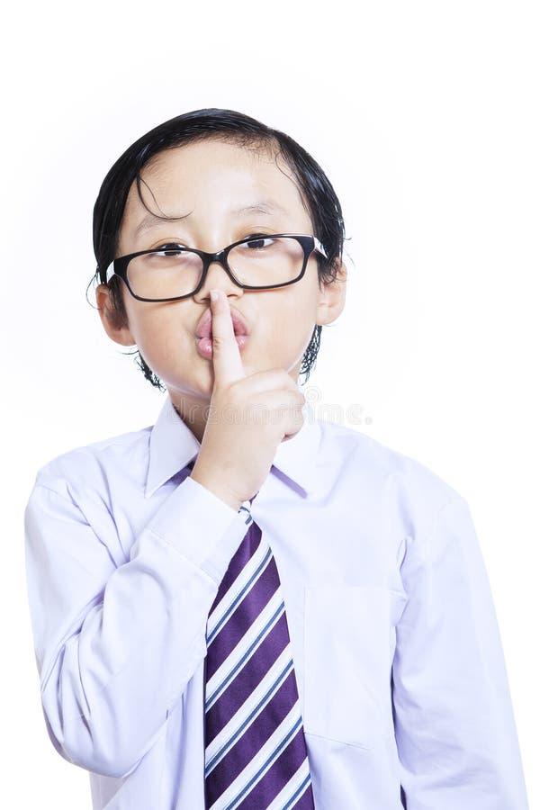 Cichy wyrażenie biznesowy dzieciak na bielu zdjęcia stock