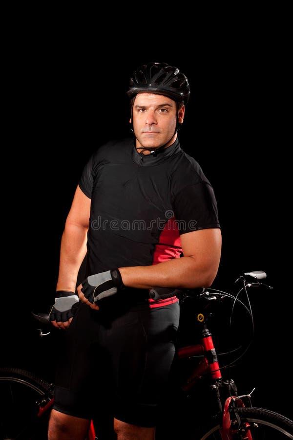 Ciclista com bicicleta fotografia de stock