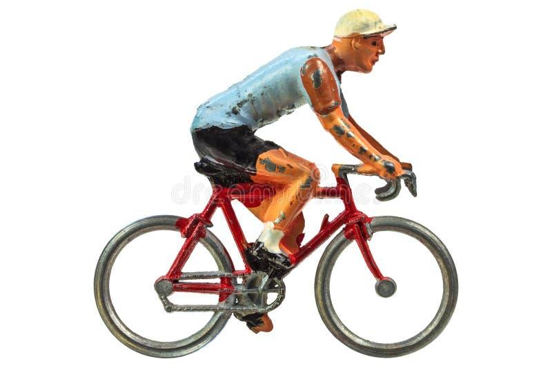 Ciclista miniatura d'annata di sport isolato su bianco immagini stock