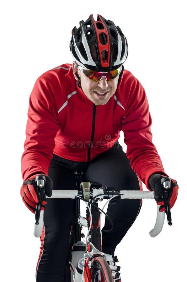 Ciclista que monta uma bicicleta fotografia de stock