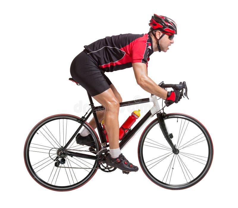 Ciclista que monta una bicicleta imagenes de archivo