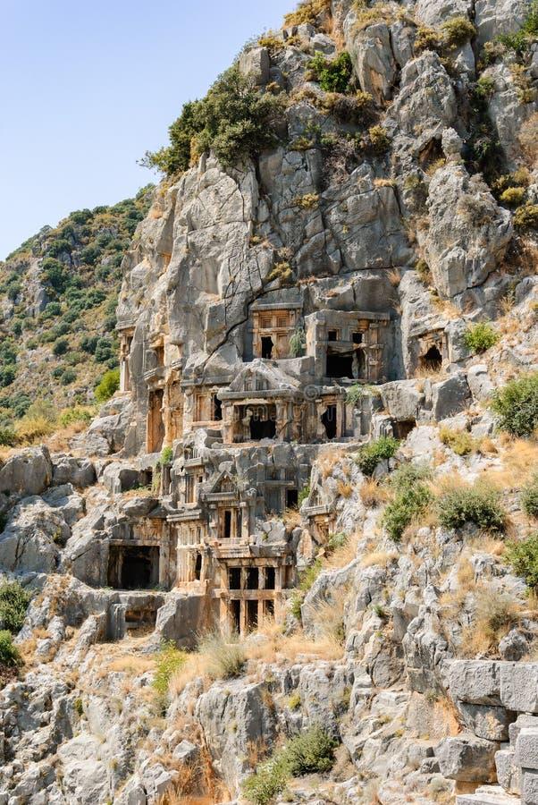 Cidade antiga de Myra perto de Demre Turquia, túmulos feitos na rocha imagens de stock royalty free