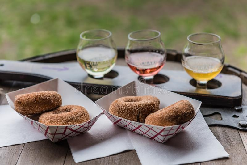 Cider Donuts with Angry Orchard Ciders. Pine Bush, NY /USA - June 9, 2018: Cider donut making station at Angry Orchard Cidery stock photo