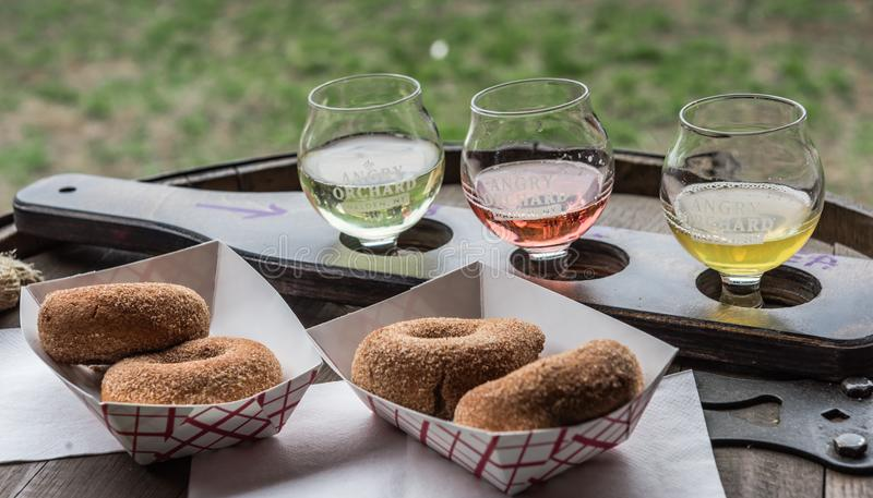 Cider Donuts and Cider Samples. Pine Bush, NY /USA - June 9, 2018: Cider donut making station at Angry Orchard Cidery royalty free stock photography