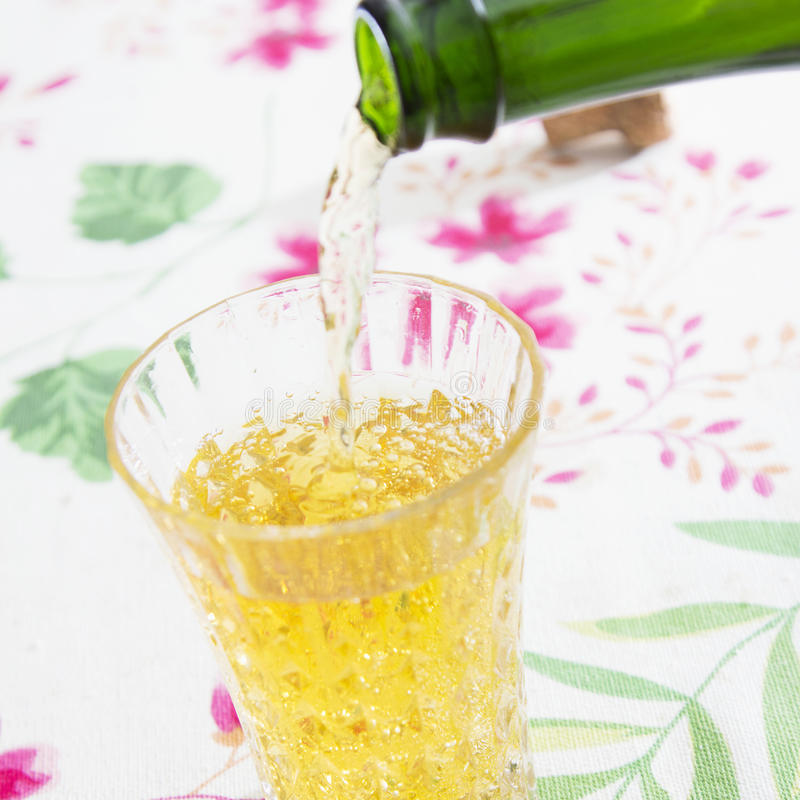Cider. Pouring into a glass stock photo