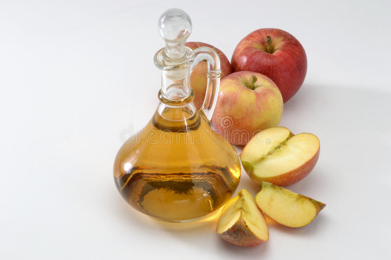 Cider vinegar. Bottle and red apples royalty free stock photography