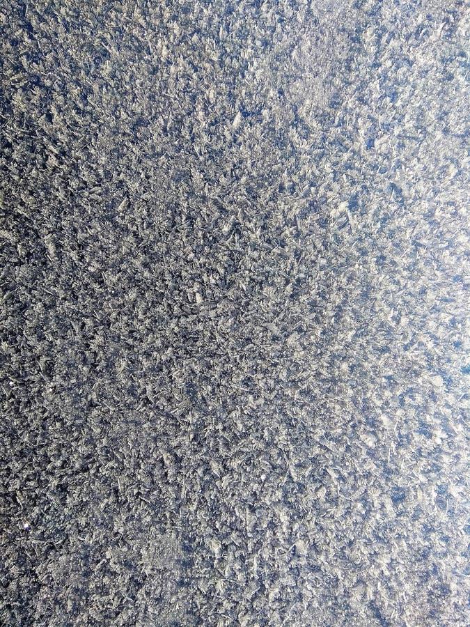 Ciekawej zimy śnieżna tekstura w mrozowej naturze fotografia stock
