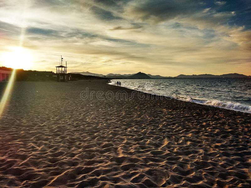 Ciel de mer de plage de coucher du soleil d'aube images libres de droits