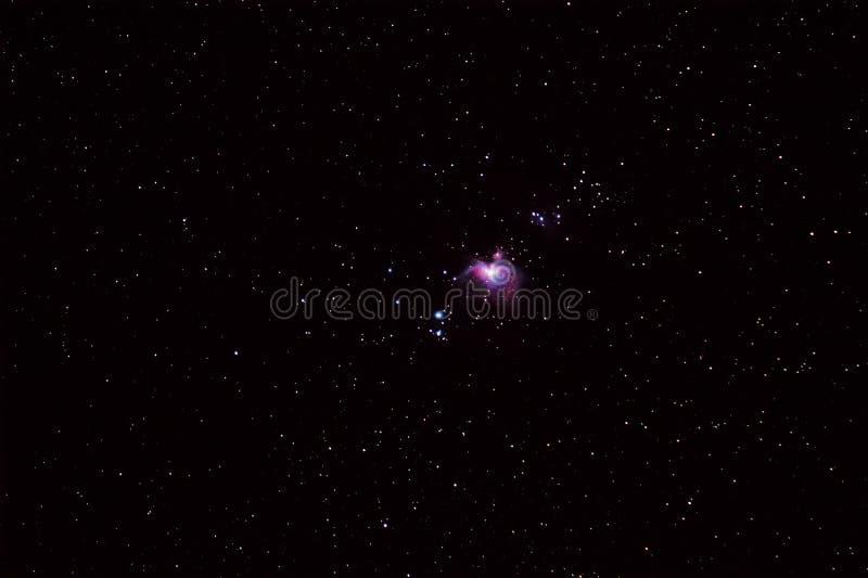 Cielo notturno con la grande nebulosa M42 di Orione fotografia stock libera da diritti