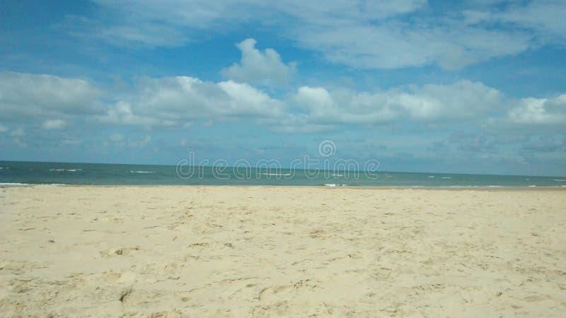 Cielo, océano y playa fotografía de archivo