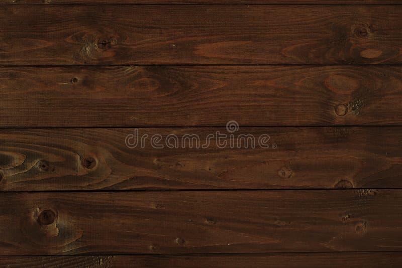 Ciemna drewniana deska dla tła lub tekstury fotografia stock