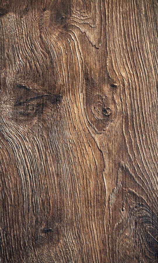 Ciemnego br?zu porysowana drewniana tn?ca deska obrazy stock