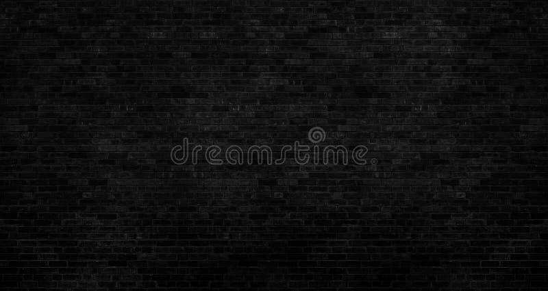 ciemnego czerni ściana z cegieł szorstką powierzchnię jako tło wizerunek obraz stock