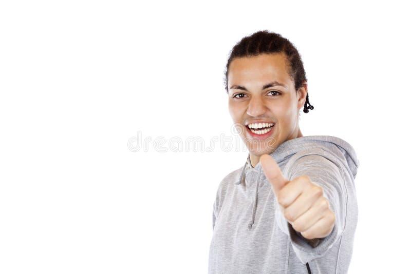 ciemni chwyty skinned nastolatka pomyślnego kciuk pomyślny fotografia royalty free