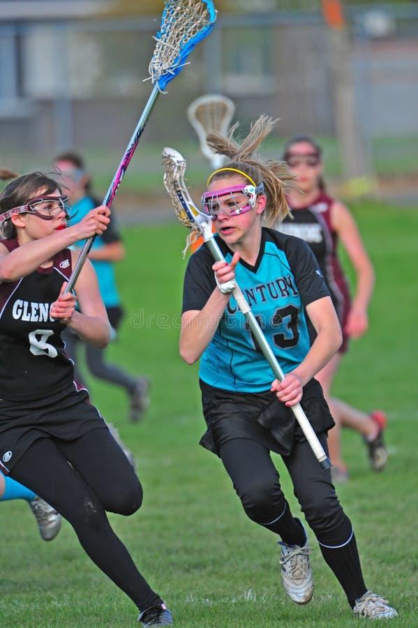 ciemnopąsowy dziewczyn lacrosse przypływ fotografia stock