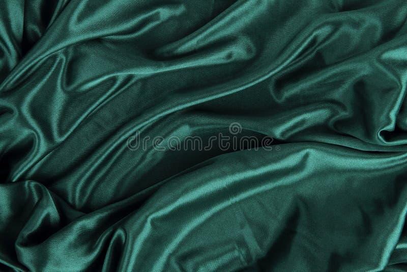 Ciemnozielony Atłasowy Jedwabniczy Aksamitny Sukienny tkaniny tło fotografia stock