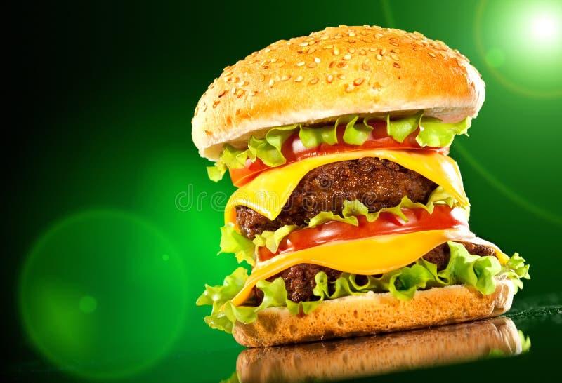 ciemny francuz smaży hamburger smakowitego zdjęcia royalty free