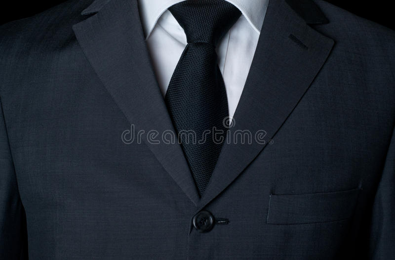 Ciemny garnitur z krawatem obrazy stock