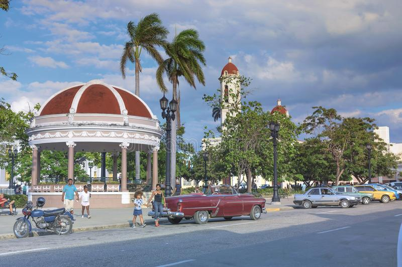 CIENFUEGOS, CUBA - January 03, 2018: The central square of the c. Ity with parked retro cars stock photo