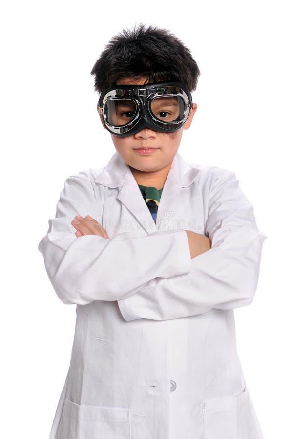 Científico joven con los anteojos imágenes de archivo libres de regalías