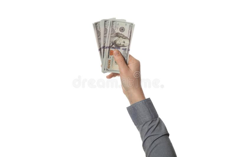 Cientos dineros de los billetes de d?lar a disposici?n aislados en el fondo blanco Renta, beneficio y ahorros fotos de archivo libres de regalías