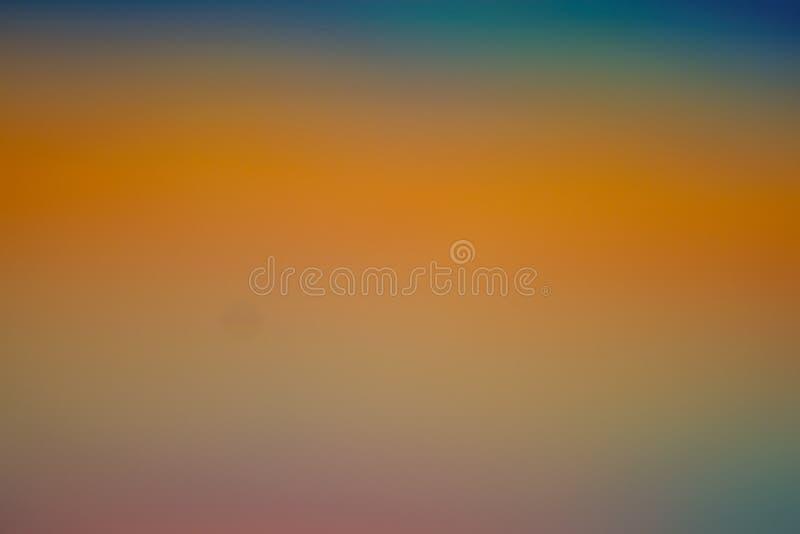 Ciepły jesieni tło w pomarańczowym złocistym kolorze żółtym i błękicie obrazy stock