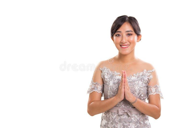 Ciepły powitanie młoda atrakcyjna etniczna Azja Południowo-Wschodnia kobieta m zdjęcie stock