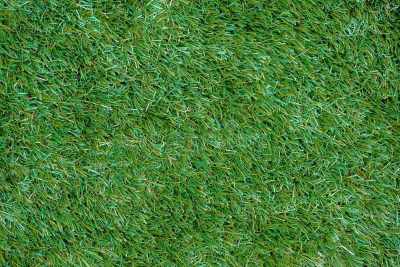Cierre artificial de la textura del fondo de la hierba encima de la visión superior imágenes de archivo libres de regalías