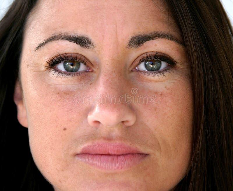 Cierre bastante español de la cara de la mujer para arriba foto de archivo libre de regalías