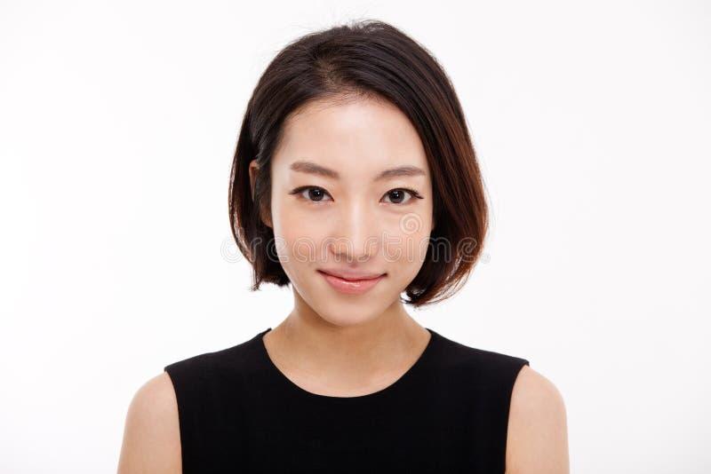 Cierre bonito asiático joven de la mujer de negocios encima del retrato. foto de archivo