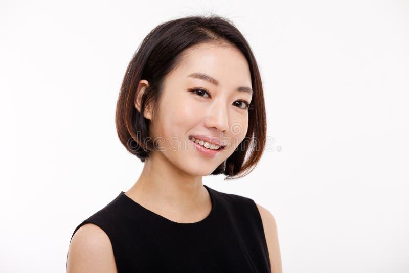 Cierre bonito asiático joven de la mujer de negocios encima del retrato. imagen de archivo