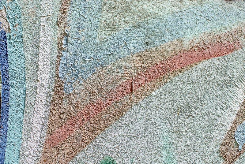 Cierre colorido encima de la textura de la pared del yeso para los fondos y las texturas interesantes fotografía de archivo