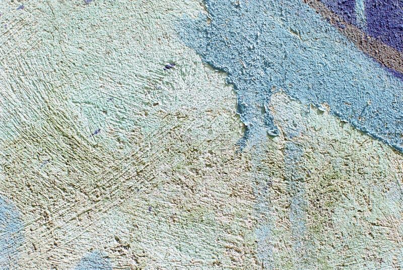 Cierre colorido encima de la textura de la pared del yeso para los fondos y las texturas interesantes fotos de archivo libres de regalías