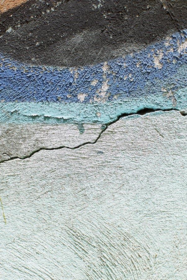 Cierre colorido encima de la textura de la pared del yeso para los fondos y las texturas interesantes imagen de archivo