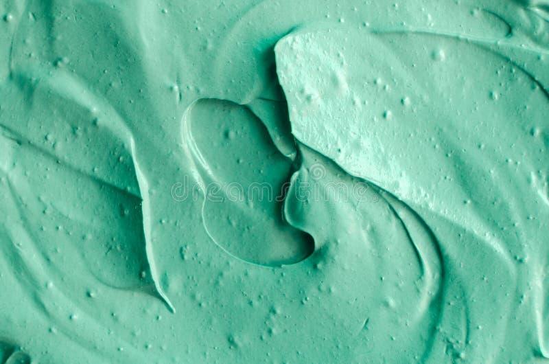 Cierre cosmético verde de la textura de la arcilla para arriba, foco selectivo abstraiga el fondo imagenes de archivo