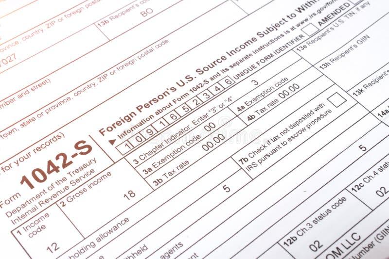 Cierre de la forma de impuesto 1042 para arriba fotos de archivo libres de regalías