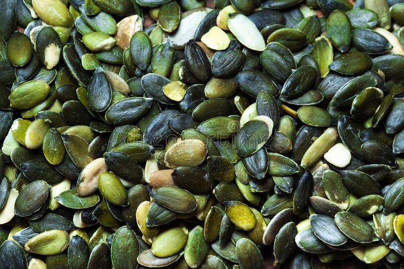 Cierre de la imagen de la opinión superior del fondo de las semillas de calabaza fotografía de archivo