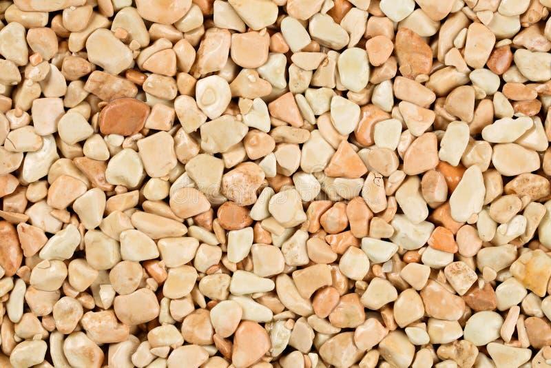 Cierre encima de la alfombra de piedra natural, beige extremo y color nata en diversos sombras y tintes del beige Capa de la pied fotos de archivo