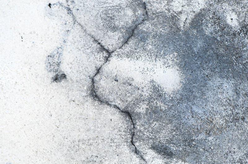 Cierre encima del fondo texturizado cemento agrietado fotografía de archivo