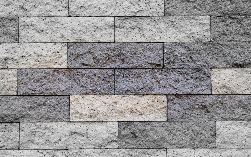 Cierre encima del modelado de bloques del granito en la pared imagen de archivo libre de regalías