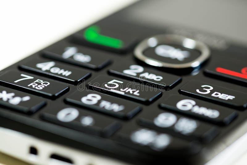Cierre encima del tiro macro, profundidad del telclado numérico del teléfono móvil del campo baja fotos de archivo libres de regalías