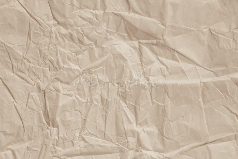 Cierre para arriba de la hoja brillante del papel de la textura de la arruga la luz entonó arte imagenes de archivo