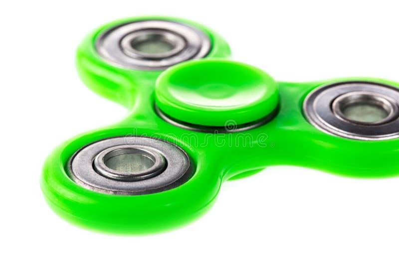 Cierre verde del hilandero de la persona agitada para arriba, juguete del alivio de tensión aislado en el fondo blanco fotos de archivo libres de regalías