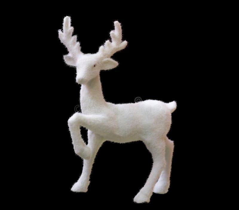 Ciervos blancos de la Navidad de la forma decorativa del juguete con la piel imagenes de archivo