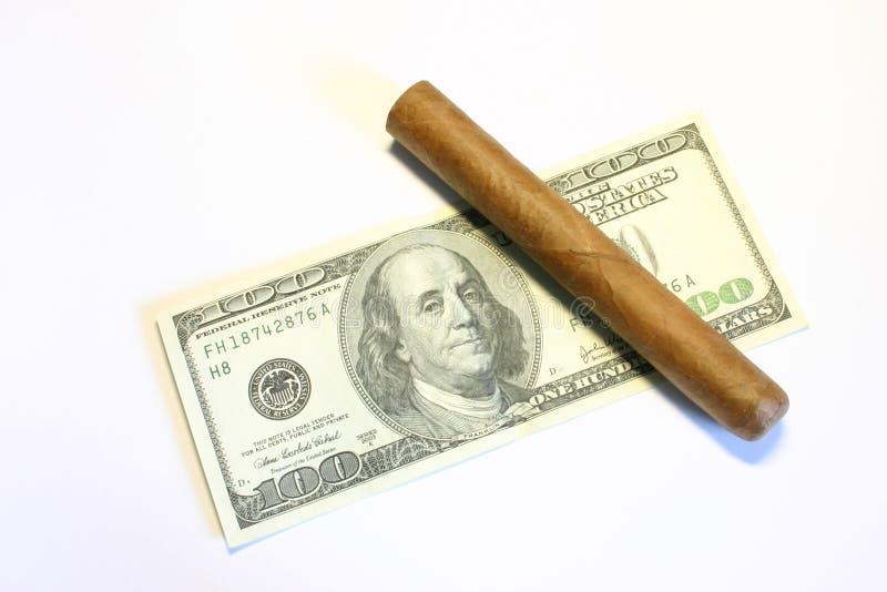 Cigar and dollars royalty free stock photo