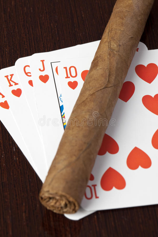 Cigar and playing cards stock photos
