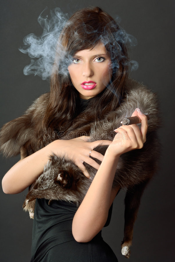 Cigare et dame photo libre de droits