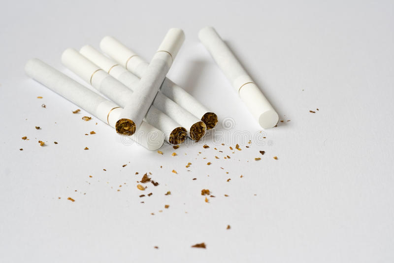Cigarets. White filter cigarets - tabaco - isolated royalty free stock images