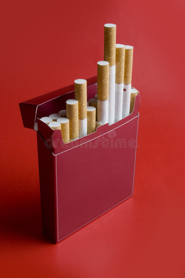 Cigarette. Box of cigarettes on red background stock photo