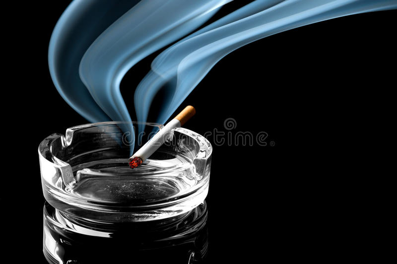 Cigarette on ashtray royalty free stock photo